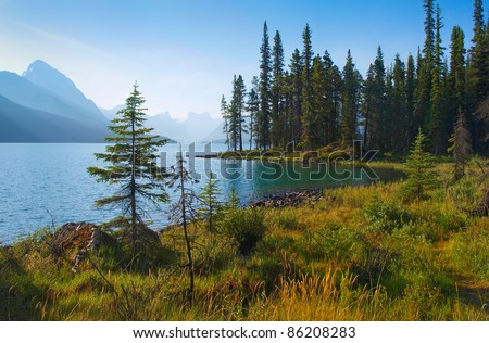 Beautiful landscape with mountain lake at dawn in Jasper National Park, Alberta, Canada - stock photo