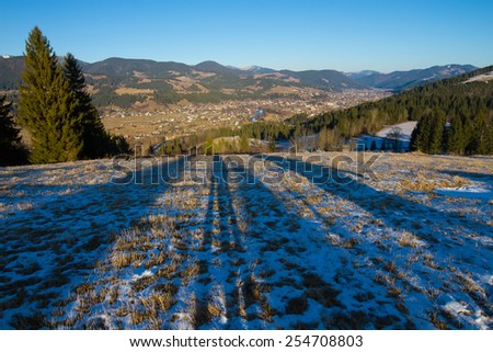 Beautiful landscape with mountains on the panorama of the city. Fairytale
