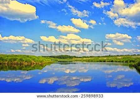 Beautiful Landscape with reflection on River Blue Sky and Clouds  - stock photo