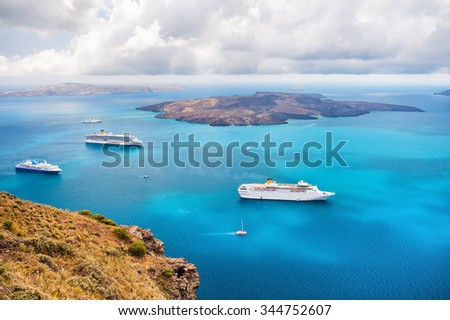 Beautiful landscape with sea view. Cruise ships at the sea near the islands. Santorini island, Greece. - stock photo