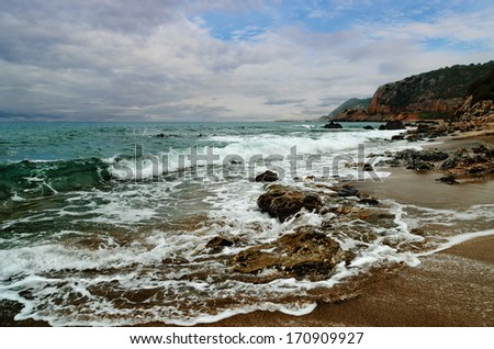 Beautiful landscape with sea waves and cloudy sky - stock photo