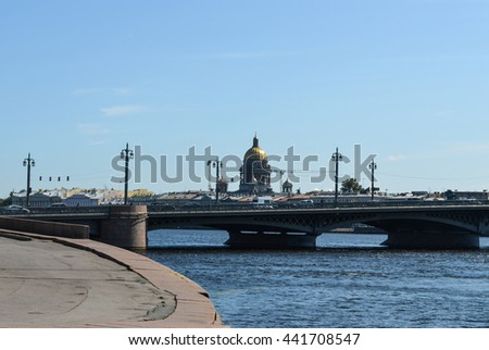 Beautiful landscape with the river Neva, bridge, church, cars. Saint Isaac's Cathedral. Saint Petersburg, Russia. View of the embankment. Summertime, august. For posters, postcards, calendars designs. - stock photo