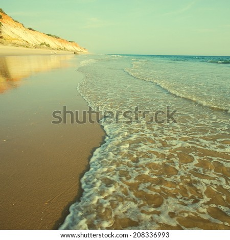 beautiful landscape with wave and tide on the coast of Athlantic ocean, Algarve, Portugal. instagram effect, square image - stock photo