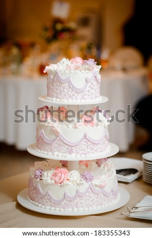 beautiful large decorated wedding cake in the restaurant - stock photo