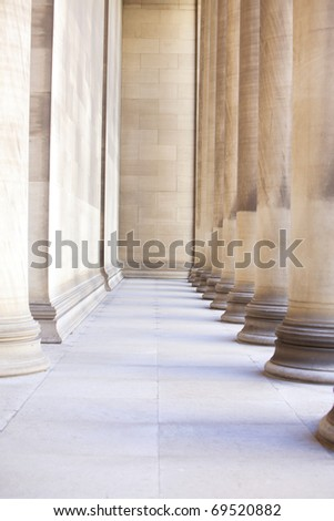 Beautiful large exterior columns made of plaster and marble - stock photo