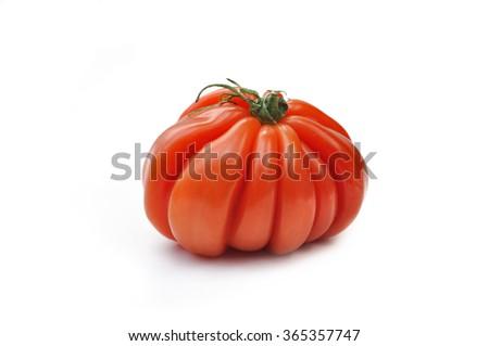 beautiful large-fruited beef tomato isolated on white background - stock photo