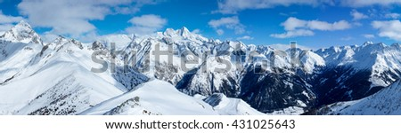 Beautiful large scale panorama shot of the impressive alpine landscape of the Autrian Hohe Tauern region surrounding Austria's highest mountain, the Grossglockner, shot on a lovely winter's day - stock photo
