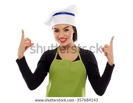 Beautiful latino cook pointing up to copyspace, isolated on white - stock photo