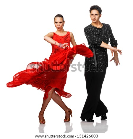 Beautiful Latino dancers in action. Isolated on white - stock photo