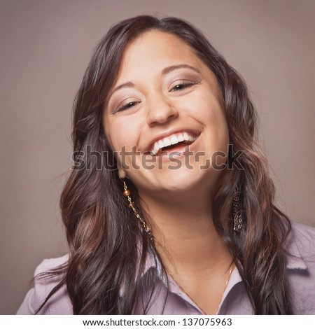 Beautiful laughing ethnic happy young woman - stock photo