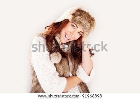Beautiful laughing fashion model wearing winter fur garments, upper body studio portrait on white - stock photo