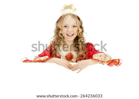 Beautiful laughing little girl with long blonde hair in the princess costume showing the sign - stock photo