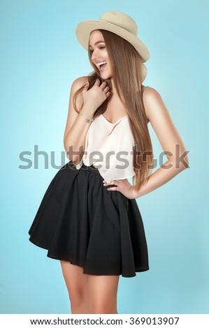 Beautiful laughing woman wearing hat. Fresh summer portrait - stock photo