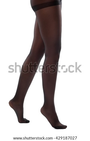 Beautiful legs in nice pantyhose white background - stock photo