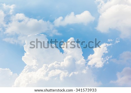 Beautiful light blue sky with puffy white clouds in happy morning day with fresh holiday and freedom feeling  - stock photo