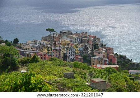 Beautiful light illuminates the village of Corniglia in the Cinque Terre on Italy's Ligurian coast - stock photo