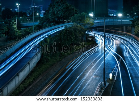 beautiful light trail at the busy highway - stock photo
