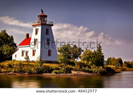 Beautiful Lighthouse Framed Against The Sky - stock photo