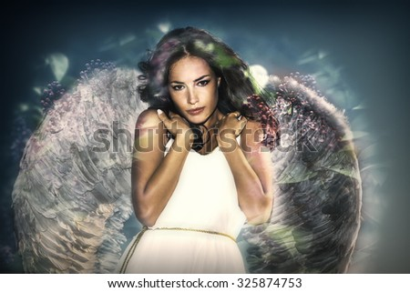 beautiful like angel young  woman with wings double exposure - stock photo