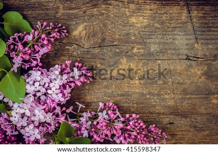 Beautiful lilac flowers on a wooden vintage board with place for text Happy Mothers Day. Toned picture. Mother's Day greetings card. Vintage still life. Mother's day. Mothers Day gift. Mothers Day. - stock photo
