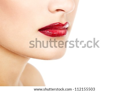 Beautiful lips of young gorgeous fresh woman with vivid red lipstick, face detail. Isolated over white background - stock photo