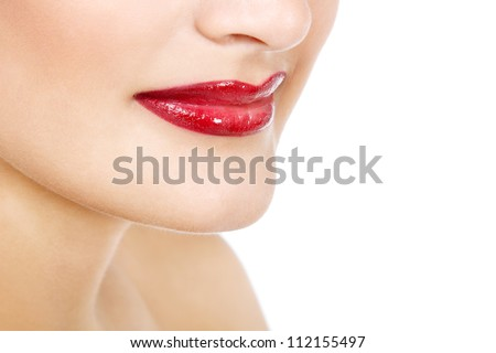 Beautiful lips with smile of young gorgeous fresh woman with vivid red lipstick, face detail. Isolated over white background - stock photo
