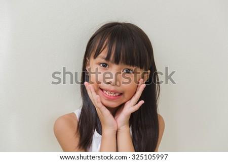 Beautiful little asian kids girl smile on white background - stock photo