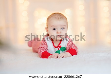 Beautiful little baby celebrates Christmas. New Year's holidays. - stock photo