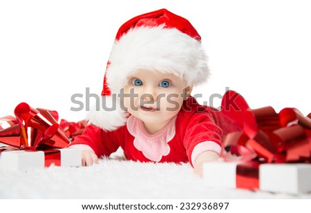 Beautiful little baby celebrates Christmas. New Year's holidays. Baby in a Christmas costume with gift. Isolated - stock photo