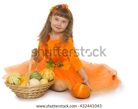 Beautiful little blonde girl with wavy , long, blond hair and short bangs on the head,in a bright orange dress sits on the floor with basket full of vegetables - Isolated on white background - stock photo