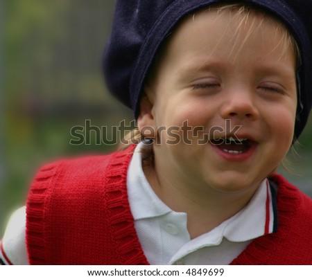 Beautiful little boy laughing, joyful - stock photo