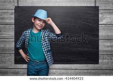 Beautiful little boy on the background of the school board. Empty space for text. School lessons. Back to school. Colored backgrounds - stock photo