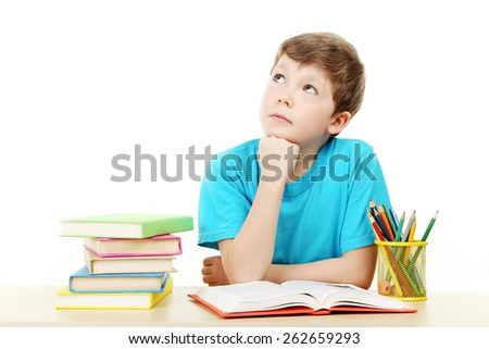 Beautiful little boy studying isolated on white - stock photo