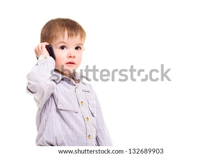 Beautiful little boy talking on a mobile phone - stock photo