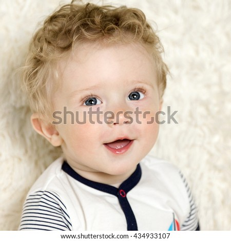 beautiful little boy with curly hair - stock photo