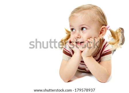 Beautiful little caucasian girl sitting on her belly over white background - stock photo