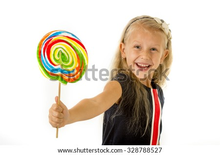 beautiful little female child with sweet blue eyes and long blond hair holding huge lollipop spiral candy smiling happy isolated on white background in children loving sweet and caramel concept - stock photo