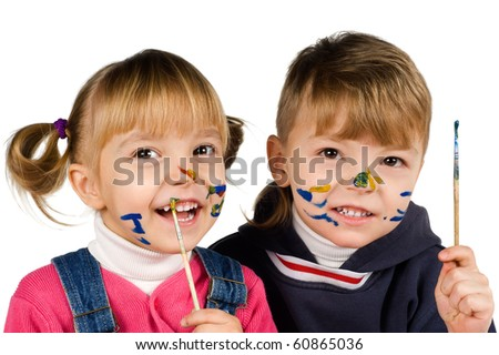 Beautiful little girl and boy is drawing with gouaches - stock photo