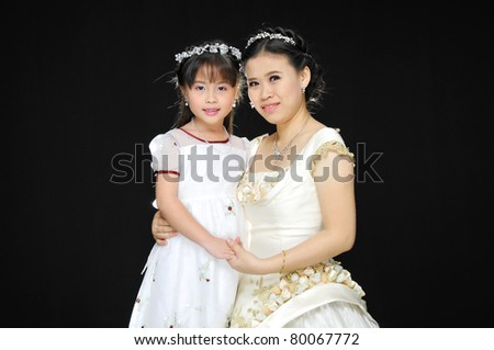 Beautiful little girl and her mother - stock photo