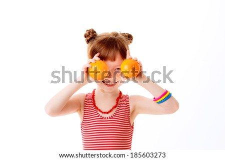 beautiful little girl citrus isolated on white background. happiness.   - stock photo