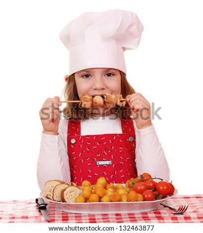 beautiful little girl cook eat grilled chicken meat - stock photo
