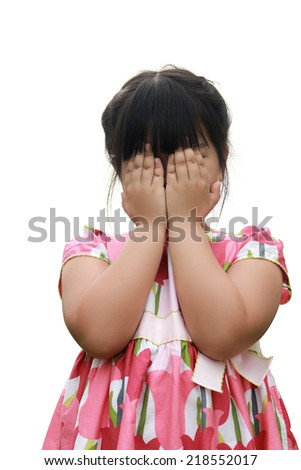 Beautiful little girl covering her eyes with her hands - stock photo