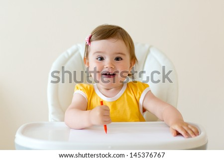 beautiful little girl drawing with pencils - stock photo