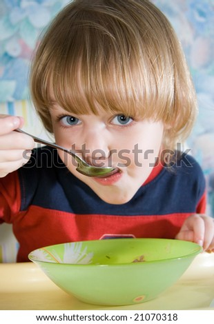 beautiful little girl during a meal - stock photo