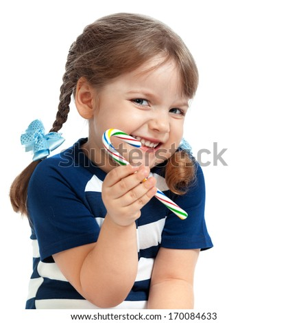 beautiful little girl eating candy sweetness - stock photo