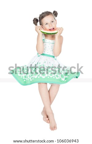 beautiful little girl eating watermelon and sitting over white background - stock photo