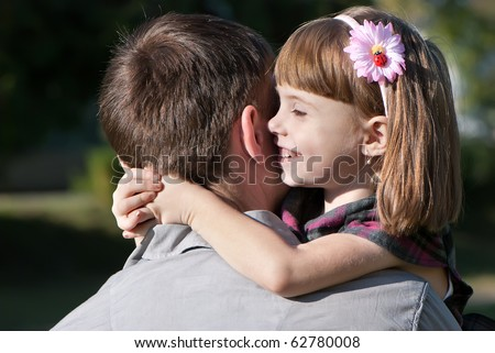 beautiful little girl hugging embracing her father - stock photo