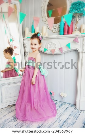 Beautiful little girl in a pink dress - stock photo