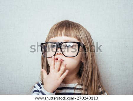 Beautiful little girl in glasses  - stock photo