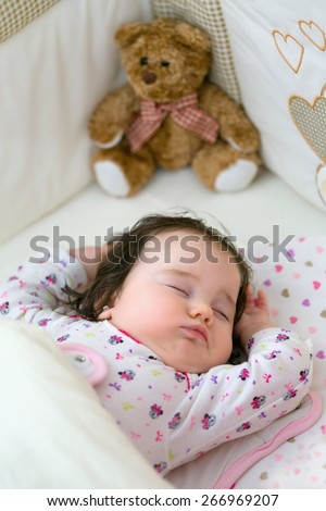 Beautiful little girl in her sleep stretching - stock photo